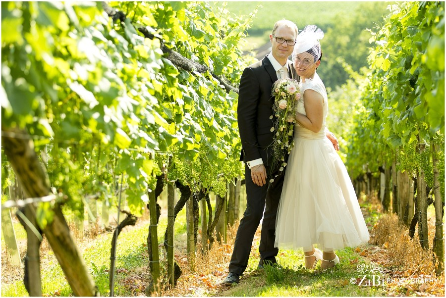 bride and groom in an alley grapes
